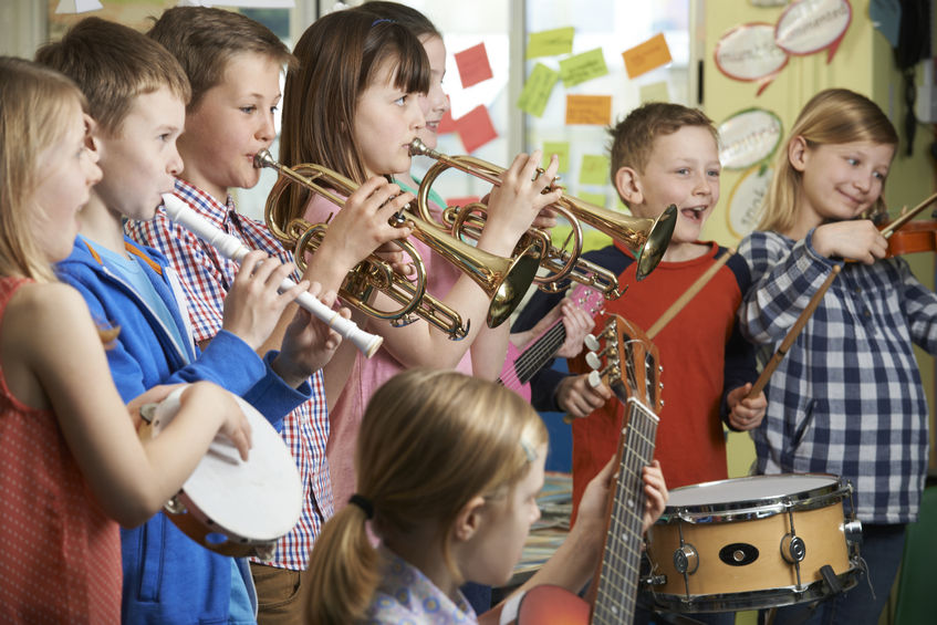 44634338-Group-Of-Students-Playing-In-School-Orchestra-Together-Stock-Photo
